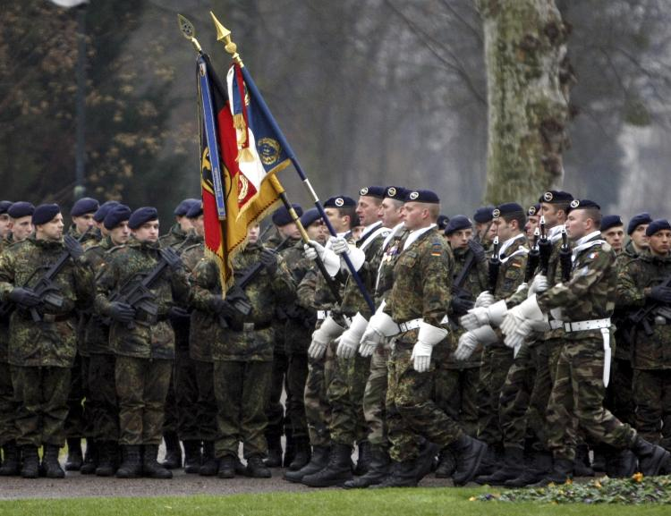 COOPERATIVE SERVICE: German and French troops parade during a ceremony in the eastern French city of Strasbourg on Dec. 10, to mark the deployment of the first German combat unit to be stationed in France since the end of World War II. (Christian Lutz/AFP/Getty Images)